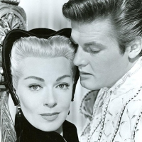 Lana Turner and Roger Moore - 12 Jan. 1956: Diane