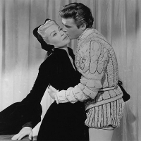 Lana Turner and Roger Moore - 12 Jan. 1956: Diane